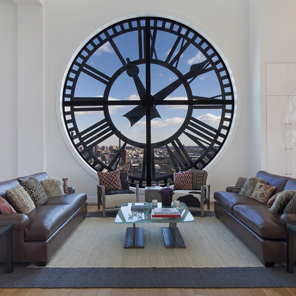Clock-Tower-Apartment-White-open-plan-living-with-clock-face-window-leather-and-textural-rug.jpg