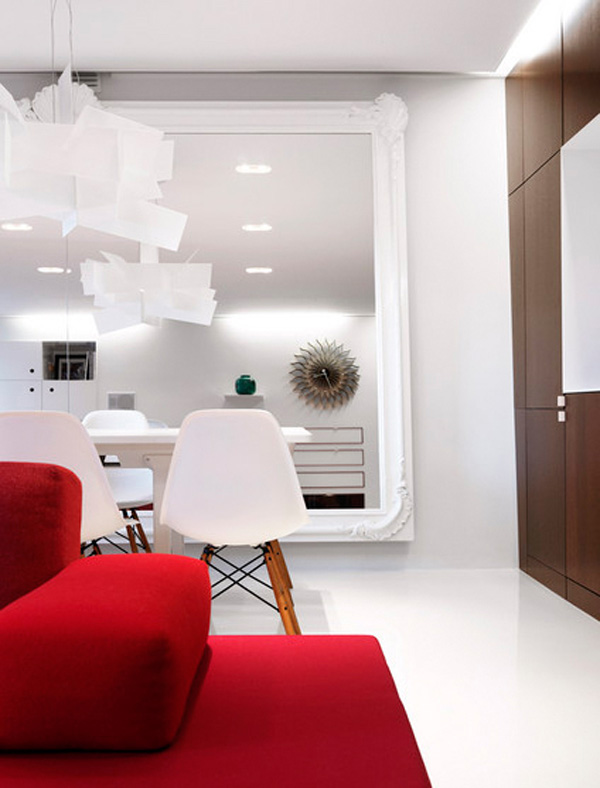 white-walls-and-eames-eiffel-wood-base-chairs-with-bold-red.jpg